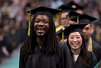 Steven Word, B.B.A. Management Information Systems, waits to receive his degree during UAA's 2019 Spring Commencement at the Alaska Airlines Center.