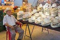 Tlacolula; Oaxaca; Mexico.  Tlacolula Market.  Sleeping Man Selling Hats.