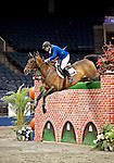 Michael Morrissey and Scaraberas (USA), winner of the puissance competition, clearing a 7 foot wall