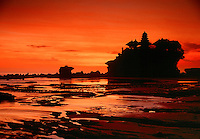 Rock perched Pura Tanah Lot Temple at sunset Bali Indonesia.