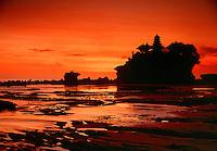 Rock perched Pura Tanah Lot Temple at sunset Bali Indonesia.