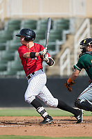 Alex Call (1) of the Kannapolis Intimidators follows through on his swing against the Greensboro Grasshoppers at Kannapolis Intimidators Stadium on August 13, 2017 in Kannapolis, North Carolina.  The Grasshoppers defeated the Intimidators 4-1 in 10 innings in the completion of a game suspended on August 12, 2017.  (Brian Westerholt/Four Seam Images)