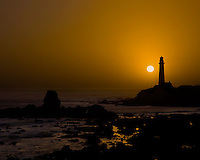 Setting sun behind Pigeon Point Lighthouse, San Simeon, California