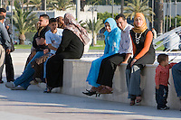 Tripoli, Libya, North Africa - Young Libyan Men and Women's Clothing Styles as seen in Public Park near the Green Square, downtown Tripoli.