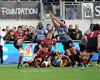 Neil de Kock of Saracens sends up a clearance kick despite the efforts of Bismarck du Plessis of Sharks during the Sanlam Private Investments Shield match between Saracens and the Cell C Sharks at Allianz Park on Saturday 25th January 2014 (Photo by Rob Munro)