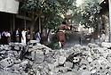 Irak 1991   La rue principale d' Halabja encombree de gravats  Iraq 1991  The main sreet of Halabja full of rubble, fragments of stone, concrete from the demolished city