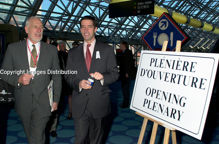 March 20 2003, Montreal, Quebec, Canada<br /> <br /> David Anderson, Canada's Environment Minister (L) and Andre Boisclair , Quebec's Environment Minister (R) arrives for the Opening plenary Session of Americana, a 3 days <br /> conference & trade show on environement and waste management,March 20 2003 in Montreal, Canada.<br /> <br /> Mandatory Credit: Photo by Pierre Roussel- Images Distribution. (©) Copyright 2003 by Pierre Roussel <br /> <br /> NOTE : <br />  Nikon D-1 jpeg opened with Qimage icc profile, saved in Adobe 1998 RGB<br /> .Uncompressed  Original  size  file availble on request.