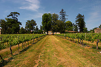 A view over the vineyard and the main chateau building in the distance Chateau de Haux Premieres Cotes de Bordeaux Entre-deux-Mers Bordeaux Gironde Aquitaine France
