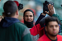 Fort Wayne TinCaps shortstop Justin Lopez (14) is congratulated by teammates after scoring a run during a Midwest League game against the Fort Wayne TinCaps at Parkview Field on April 30, 2019 in Fort Wayne, Indiana. Kane County defeated Fort Wayne 7-4. (Zachary Lucy/Four Seam Images)