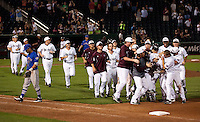 Members of the Missouri State Bears mob Kevin Medrano (13) after hitting the game winning hit during a game against the Kansas Jayhawks at Hammons Field on March 27, 2012 in Springfield, Missouri. (David Welker/Four Seam Images)