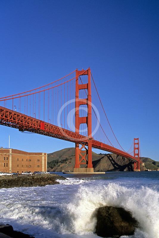 California, San Francisco, Golden Gate Bridge and Fort Point, surf on rocks