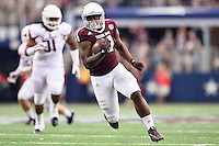 Texas A&M running back Tra Carson (21) runs for first down during second quarter of an NCAA Football game, Saturday, September 27, 2014 in Arlington, Tex. Arkansas leads 21-14 at the halftime. (Mo Khursheed/TFV Media via AP Images)
