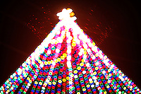 Zilker Park Holiday Tree shines bright with thousands of multi-color Christmas lights streamed from a 155 foot Christmas tree made from lights draped from a moonlight tower located in Zilker Park.
