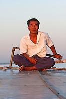Myanmar, Burma, near Bagan.  Passenger Boat Pilot, Ayeyarwady River.
