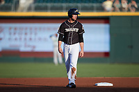 Blake Rutherford (6) of the Charlotte Knights takes his lead off of second base against the Gwinnett Stripers at Truist Field on July 15, 2021 in Charlotte, North Carolina. (Brian Westerholt/Four Seam Images)