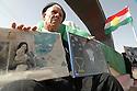 Iraq 2008.Commemoration of Halabja's chemical bombing, an inhabitant showing photos of victims   Irak 2008. Commemoration a Halabja du bombardment chimique, un habitant montre des photos des victimes
