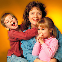 Portrait of happy mother with two children.