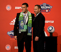 MLS executive vice president Todd Durbin welcomes Mike Seamon of Villanova to the stage as the 27th overall pick of  the MLS Superdraft by the Seattle Sounders at the Pennsylvania Convention Center in Philadelphia, PA.