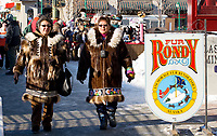 Two native women wear their fur parkas and sunglasses at the Fur Rondy Festival, downtown Anchorage.