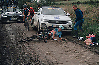2nd October 2021 Paris–Roubaix.The first ever women's edition of Paris Roubaix. Competitor goes down on cobbles next to another injured rider