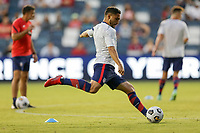 KANSAS CITY, KS - JULY 15: Cristian Roldan #10 of the United States warming up before a game between Martinique and USMNT at Children's Mercy Park on July 15, 2021 in Kansas City, Kansas.