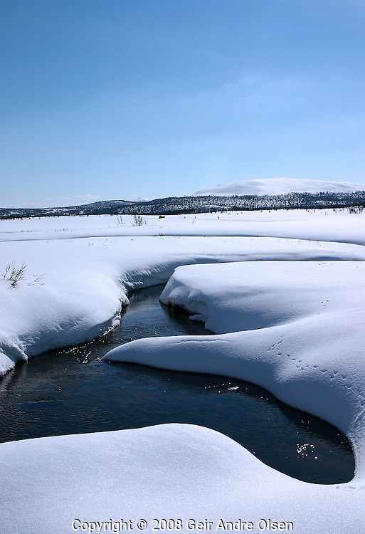 Peaceful view over a small river at Venabygdsfjell, Norway