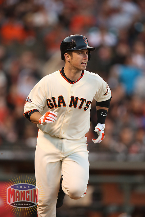 SAN FRANCISCO, CA - MAY 4:  Buster Posey #28 of the San Francisco Giants runs to first base against the Los Angeles Dodgers during the game at AT&T Park on Saturday, May 4, 2013 in San Francisco, California. Photo by Brad Mangin