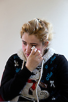 Shatha Sulaiman Kheder, 27, wipes away a tear as she recollects her family still in refugee camps in Tukwila, Wash. on January 30, 2017. She and her husband Adil Kheder Nimr, 27, and their son Steven Adil Kheder, 10 months, from Iraq arrived in the United States on as refugees on January 19, 2017, the day after Donald Trump was sworn in as the 45th president of the United States. They are concerned about thirteen of their family members still in Iraq. Trump signed an executive order last Friday   restricting immigration from seven Muslim countries, suspending all refugee admission for 120 days, and bans all Syrian refugees indefinitely.  (Photo by Karen Ducey)