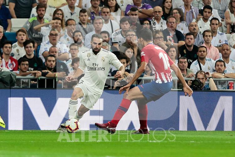 Real Madrid's Dani Carvajal and Atletico de Madrid's Rodrigo Hernandez during La Liga match between Real Madrid and Atletico de Madrid at Santiago Bernabeu Stadium in Madrid, Spain. September 29, 2018. (ALTERPHOTOS/A. Perez Meca)