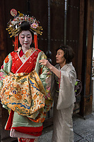 """Japan; Kyoto. Kikugawa, a Tayu or Oiran. Once known as a courtesans, they are highly educated in tea cermony, flower arranging, playing music, calligraphy, are well read and good conversationists. Her black teeth are a sign of beauty. Therare about 5 tayu today, compared to about 300 geisha. """"A tayu is my ideal woman image, I chose to be one. I was also concerned that this culture would disappear."""" Attended by her """"mother,"""" who was also a Tayu. Model released."""