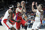 CSKA Moscow's Milos Teodosic (c) and Olympiacos Piraeus' Brent Petway (l) and Ioannis Papapetrou during Euroleague Semifinal match. May 15,2015. (ALTERPHOTOS/Acero)