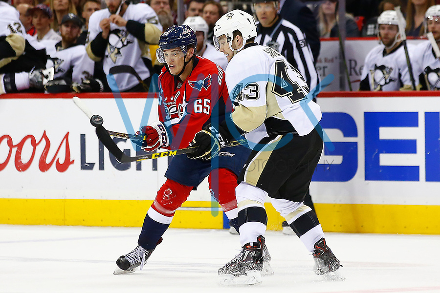 Conor Sheary #43 of the Pittsburgh Penguins and Andre Burakovsky #65 of the Washington Capitals reach for a loose puck in the air in the third period during game two of the second round of the Stanley Cup Playoffs at Verizon Center in Washington D.C. on April 30, 2016. (Photo by Jared Wickerham / DKPS)