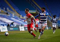 13th February 2021; Madejski Stadium, Reading, Berkshire, England; English Football League Championship Football, Reading versus Millwall; Josh Laurent of Reading challenges Ben Thompson of Millwall