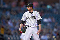 Charlotte Knights starting pitcher Ross Detwiler (9) looks to his catcher for the sign against the Rochester Red Wings at BB&T BallPark on May 14, 2019 in Charlotte, North Carolina. The Knights defeated the Red Wings 13-7. (Brian Westerholt/Four Seam Images)