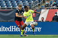 FOXBOROUGH, MA - MAY 12: Illal Osumanu #28 of Union Omaha attempts to control the ball as Justin Rennicks #12 of New England Revolution II defends during a game between Union Omaha and New England Revolution II at Gillette Stadium on May 12, 2021 in Foxborough, Massachusetts.