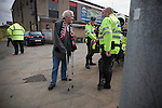 Crusaders 1 Fulham 3, 16/07/2011. Seaview Park, Europa League 2nd qualifying round first leg. An elderly home team fan talking to police officers inside Seaview Park, Belfast before Northern Irish club Crusaders take on Fulham in a UEFA Europa League 2nd qualifying round, first leg match. The visitors from England won by 3 goals to 1 before a crowd of 3011. Photo by Colin McPherson.