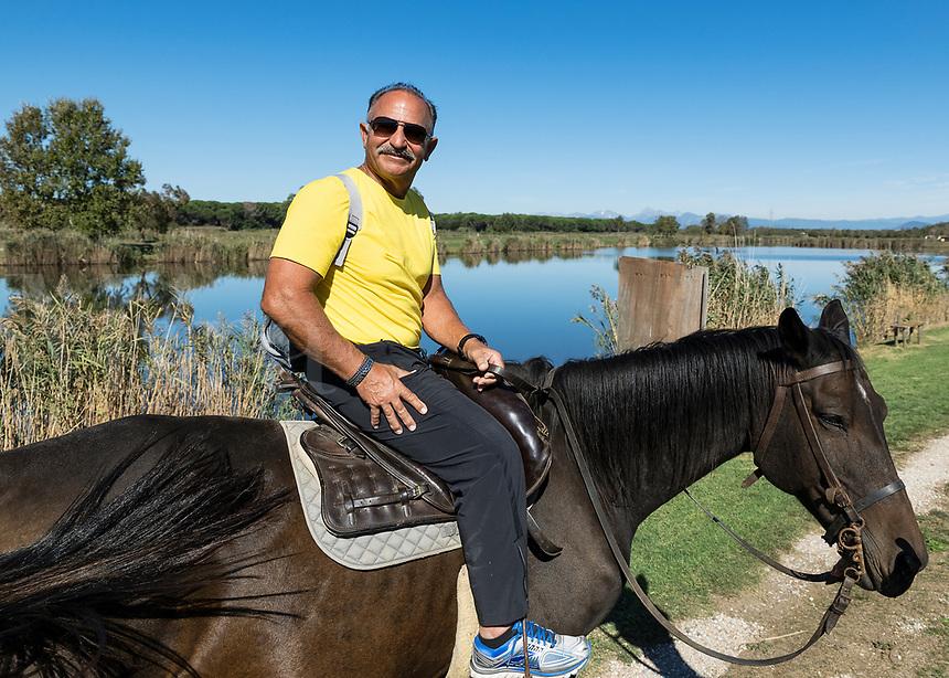 Man on a horseback excursion, Tuscany, Italy.