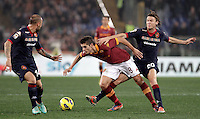 Calcio, Serie A: Roma vs Cagliari. Roma, stadio Olimpico, 1 febbraio 2013..AS Roma forward Erik Lamela, of Argentina, center, is challenged by Cagliari defender Francesco Pisano, left, and midfielder Albin Ekdal, of Sweden,  during the Italian Serie A football match between AS Roma and Cagliari, at Rome's Olympic stadium, 1 February 2013..UPDATE IMAGES PRESS/Riccardo De Luca