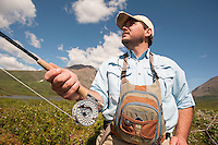 150620-JRE-7981E-0412 Cal Trout, a teacher and quail hunting guide from Mississippi, prepares to hunt  Arctic Grayling with a fly rod.