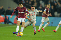 Felipe Anderson is tackled by James Milner of Liverpool during West Ham United vs Liverpool, Premier League Football at The London Stadium on 4th February 2019