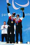 Mac Marcoux and Robin Femy, Sochi 2014 - Para Alpine Skiing // Para-ski alpin.<br /> Mac Marcoux and guide Robin Femy celebrate their Bronze medal win in the mens's Super G visually impaired event // Mac Marcoux et le guide Robin Femy célèbrent leur médaille de bronze dans l'épreuve masculine de Super G pour hommes ayant un déficience visuelle. 09/03/2014.