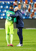 31st October 2020; The Kiyan Prince Foundation Stadium, London, England; English Football League Championship Football, Queen Park Rangers versus Cardiff City; Goalkeeper Seny Dieng of QPR receiving thanks from Manager Mark Warburton of QPR