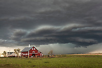 Supercell thunderstorm above a red barn in Nebraska, May 20, 2014