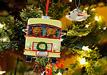 Christmas ornament of two bears driving an RV
