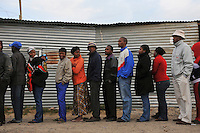 Voters wait to cast their ballots at a polling station in the Du Noon squatter area on the day of the 2009 general election.