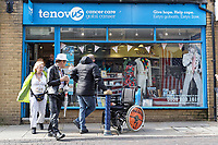 Pictured: Two festival-goers outside the Tenovus charity shop which has Elvis related items for sale in its window. Sunday 29 September 2019<br /> Re: Porthcawl Elvis Festival in south Wales, UK.