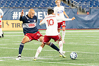 FOXBOROUGH, MA - OCTOBER 16: Tiago Mendonca #33 of New England Revolution II tackles Arturo Rodriguez #10 of North Texas SC during a game between North Texas SC and New England Revolution II at Gillette Stadium on October 16, 2020 in Foxborough, Massachusetts.
