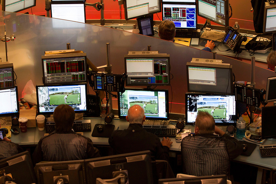 Three traders play computer golf at their workstations on the floor of the New York stock exchange.