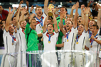 Julian Draxler of Germany celebrates winning the FIFA World Cup trophy with team mates