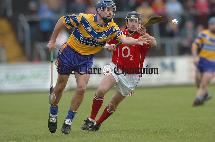 Clare's Gerry O Grady gets the ball away watched by Cork's Ben O Connor. Photograph by John Kelly.